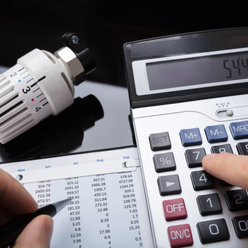 Close Up Of A Human Hand Calculating Financial Report